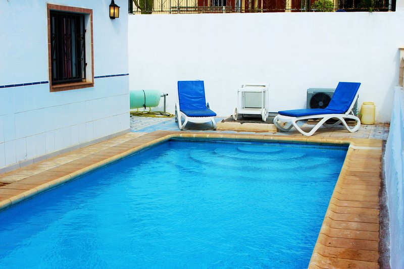 The lovely inviting swimming pool