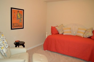 The study area has a trundle bed providing two separate twin beds, a desk, TV and reading chair.
