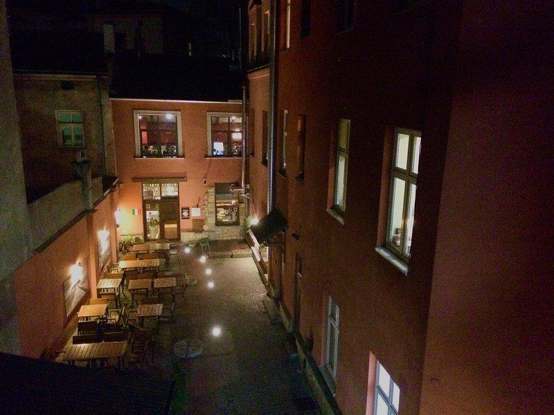 Backyard with Italian Restaurant by night