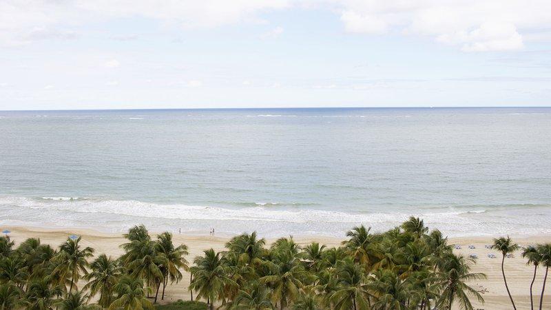 Isla Verde beach at your feet.