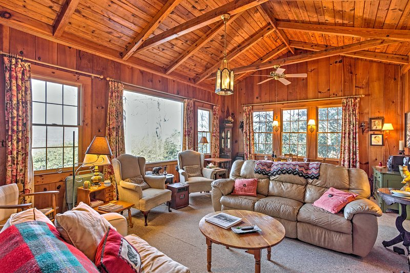 Your Smoky Mountain retreat awaits you at this rustic 5-bedroom  vacation rental house!
