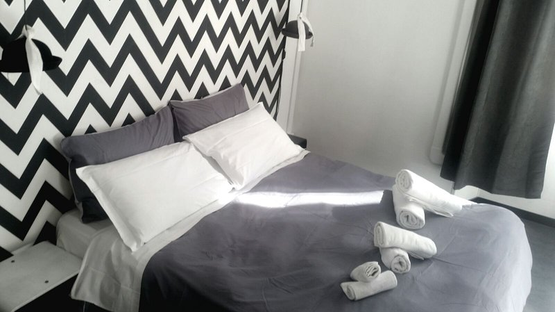 Room black & white- double bed / two single beds + third bed added. private bathroom