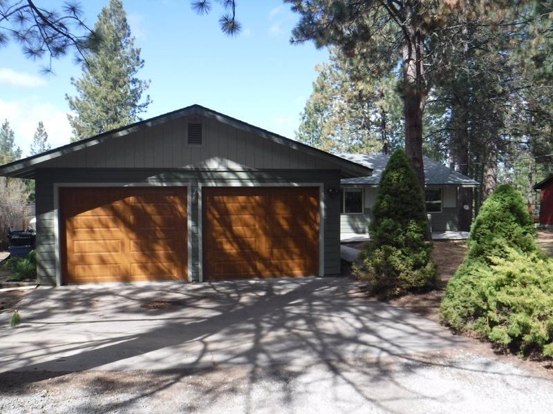 The house is located in a quiet, wooded area ,  minutes from downtown.