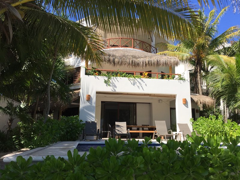 Beautiful beachfront villa in a quiet bay in Tulum, Mexico