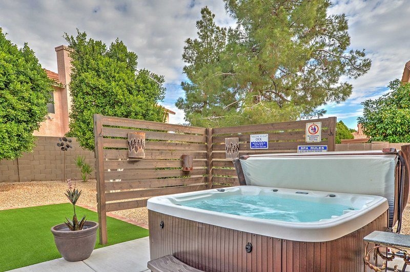 The private hot tub offers a privacy fence.