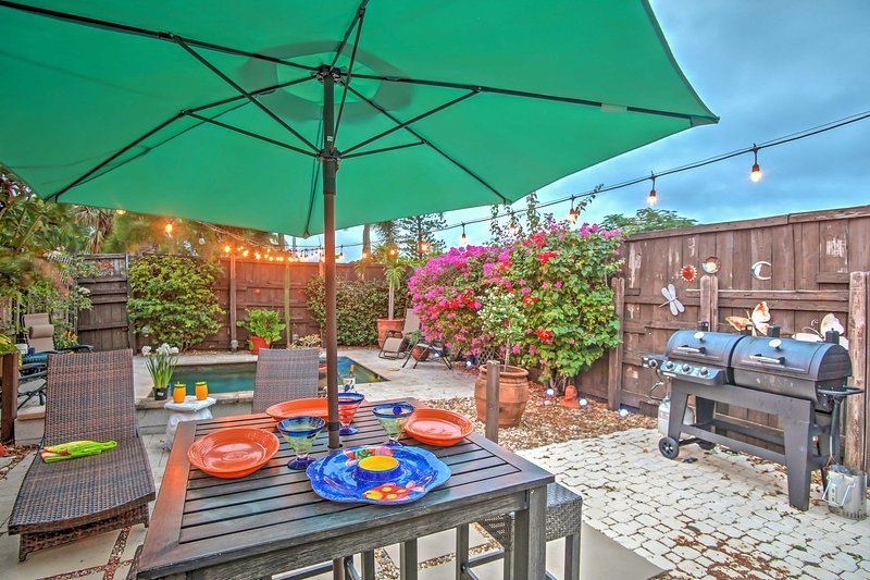 The enclosed backyard is the perfect spot for sunbathing and relaxation.