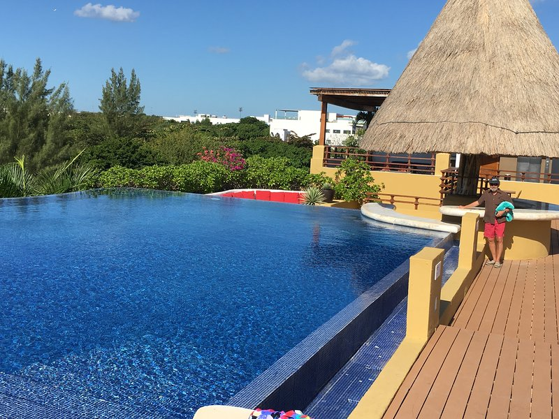 The large, adults-only rooftop infinity pool is  a highlight of our building.  Lots of loungers too!