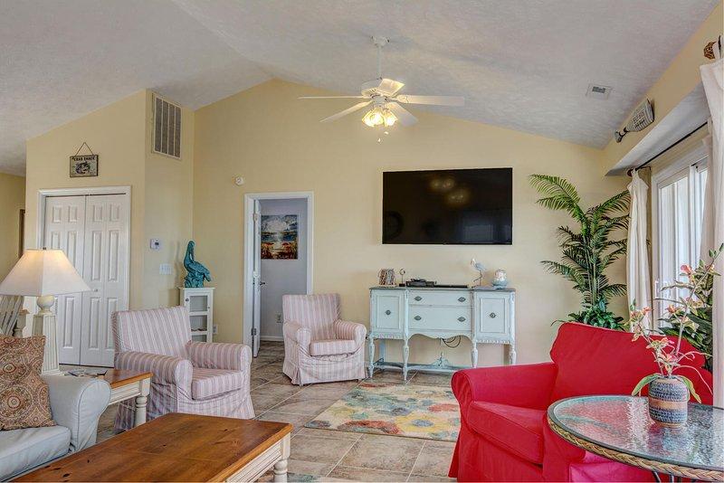 Huge Smart TV, Porcelain tile floors,  tasteful decorations throughout.