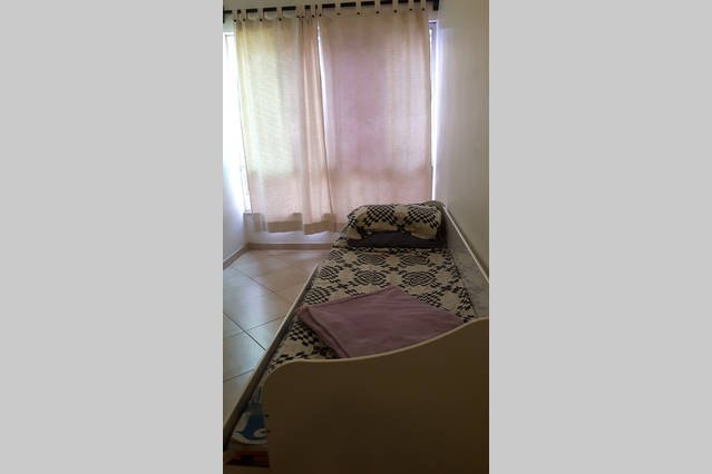 Pullout bed for two at living room corner