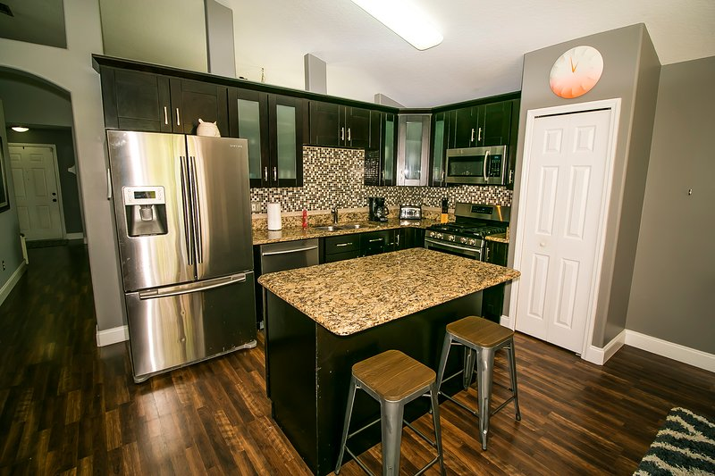 Fully upgraded kitchen with stainless steel appliances and granite countertops!