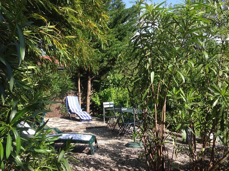 in the private garden with sun loungers, roomy shower to cool off, barbecue, table and chairs are available