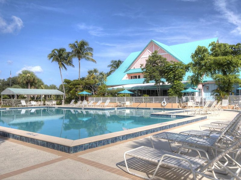 Resort like setting with heated pool with restaurant and bar adjacent