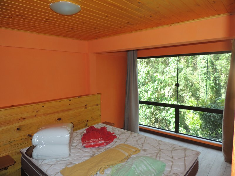 double bedroom with litter box quenn, overlooking the forest and closet
