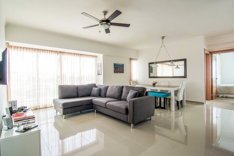 The Spacious Livingroom comes with a Fully Equipped Open Kitchen and private Balcony