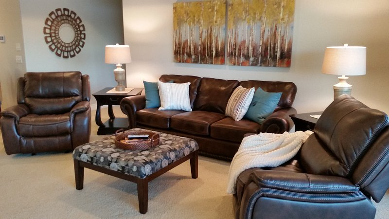 Living room.  brand new queen sleeper sofa and leather recliners