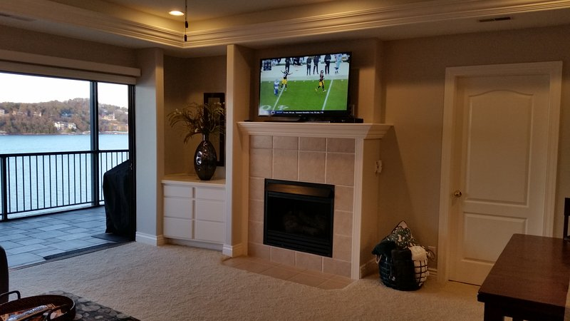 living room.  gas fireplace.  large screen Ultra High Definition Smart TV