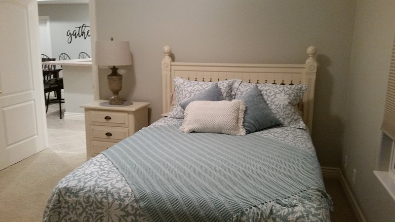 Bedroom 3.  Queen bed with adjoining main bathroom.  also includes small toddler bed