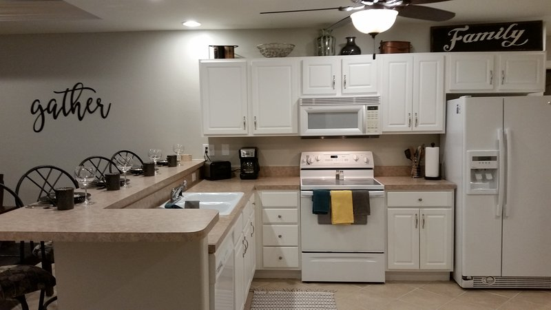 Kitchen.  brand new appliances, bakeware, pans, and dining service for 12