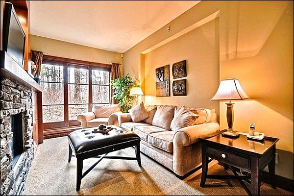 Stunning Living Room has a Gas Fireplace and Flat Screen Cable TV