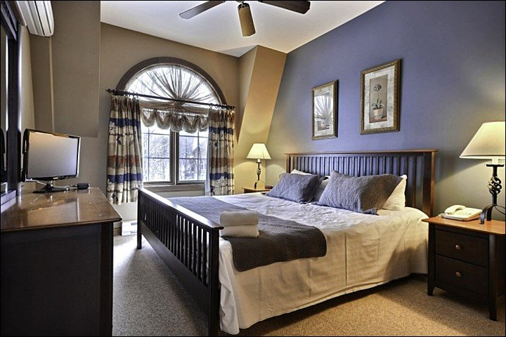 The Master En Suite Features One King Bed and a Flat Screen TV