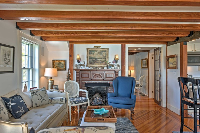 Unwind in the living room furnished with nautical decor and wood accents.