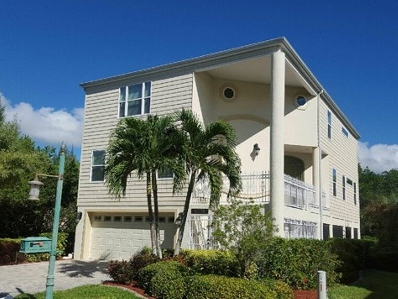 Spacious Key West style multi-level island home with elevator and boat dock near beach!