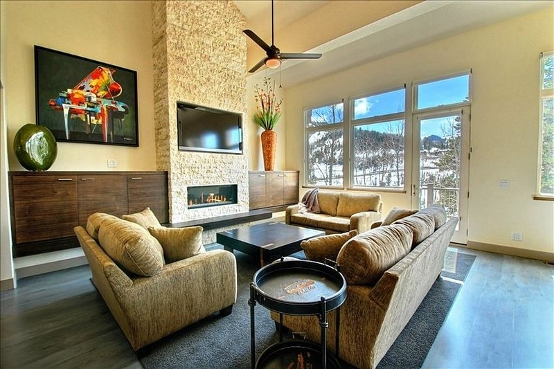 Living Room; 2 story ceiling; views West of Empire Pass, very open and bright