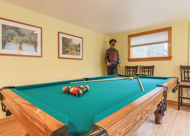 Enjoy our 8' slate pool table and new ping pong table top.