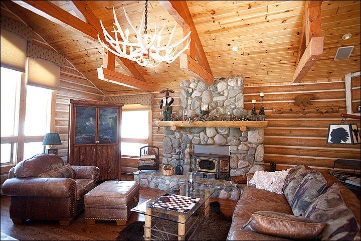 Upper Living Room - Vaulted Ceilings, Polished Antler Chandelier, & Wood Burning Fireplace.