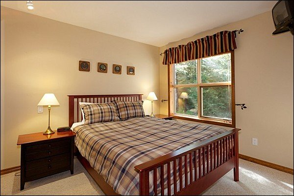 One Queen Bed is Featured in the Master Bedroom