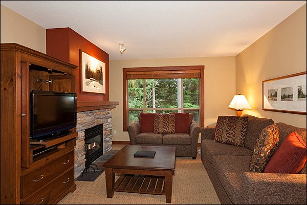 Elegant Living Room has a Flat Screen TV and Cozy Gas Fireplace