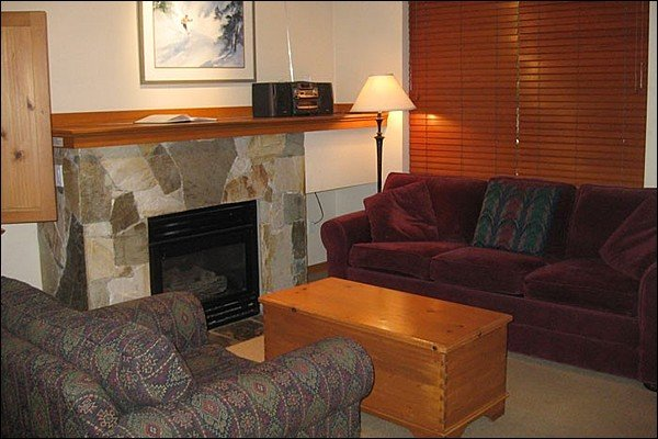 Charming and Cozy Living Area with Gas Fireplace