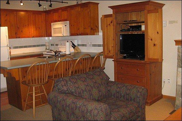 Enjoy the Flat Screen TV & Breakfast Bar Dining Area