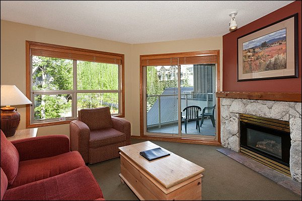 Cozy Living Area with Gas Fireplace, TV & Balcony Access