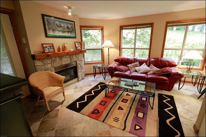 Open & Spacious Living Area with Gas Fireplace & TV