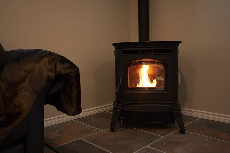 Cozy wood pellet fireplace in the living area.