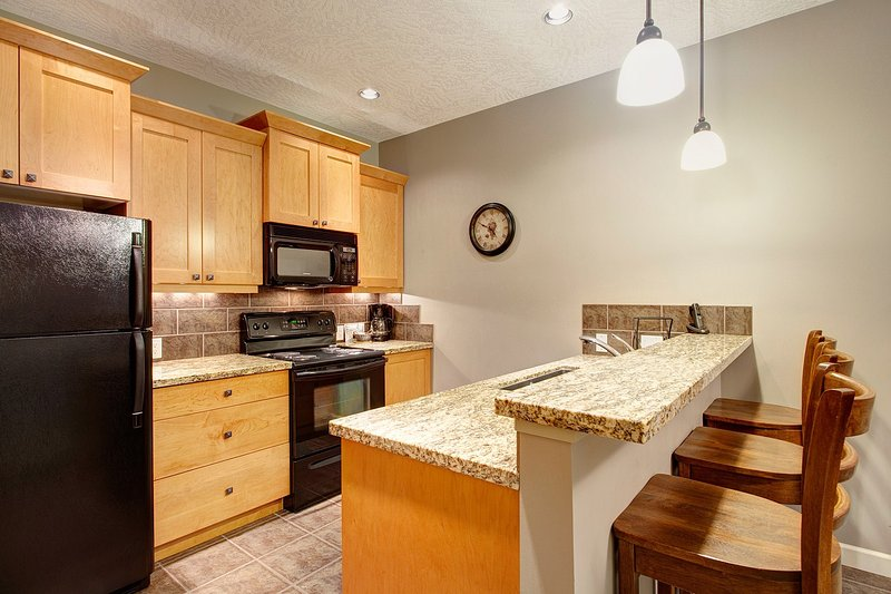 Prepare meals in your fully-equipped gourmet kitchen with granite countertops.