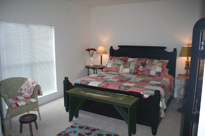 Master suite.  With private bath including large tub and twin sinks.  Large walk in closet.