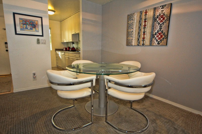 Comfortable Dining Area - lazy susan table and 2 extra chairs available for 6 people total