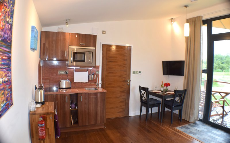 Well equipped kitchenette with microwave, 2 ring hob,  kettle, toaster and fridge. Dining for two.