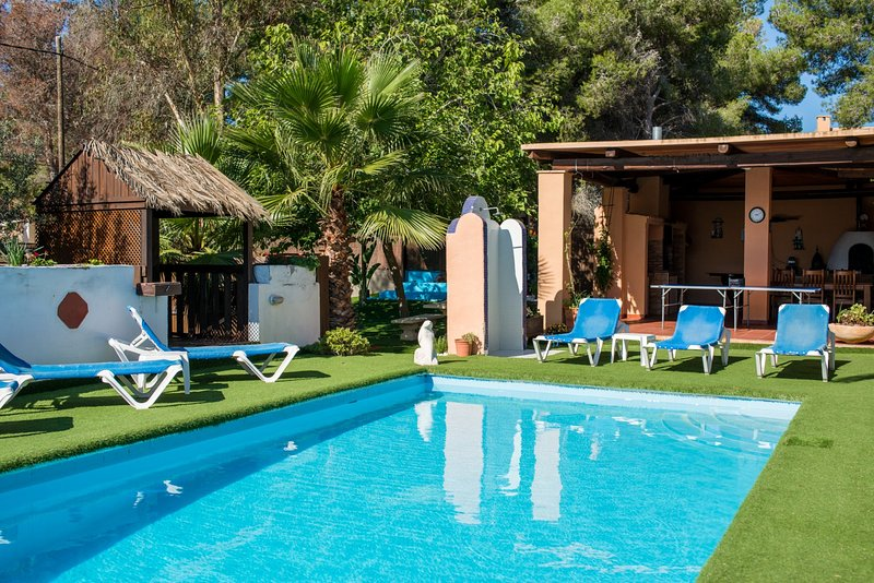 pool area with perfectly trimmed grass ground