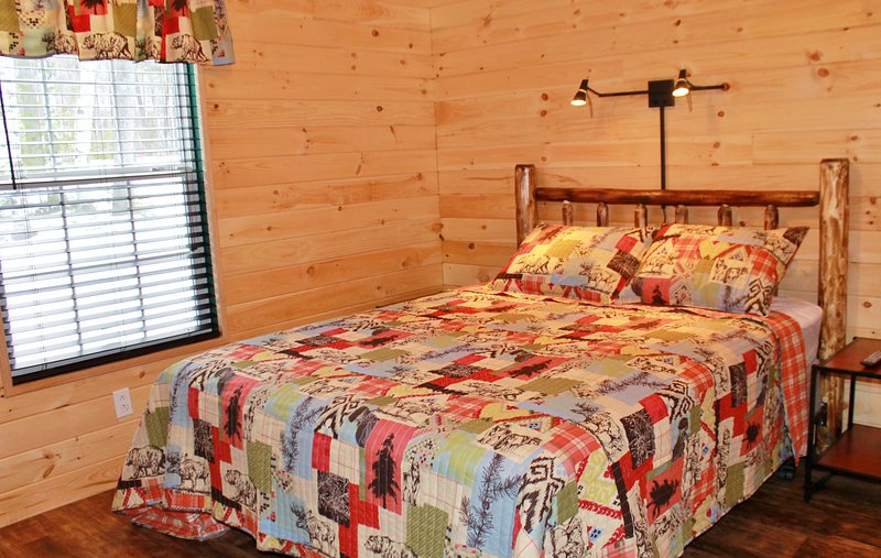 One Bedroom with Queen bed, dresser and TV