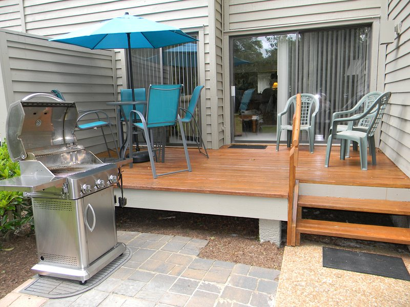 Deck Area with Umbrella and Chair Set