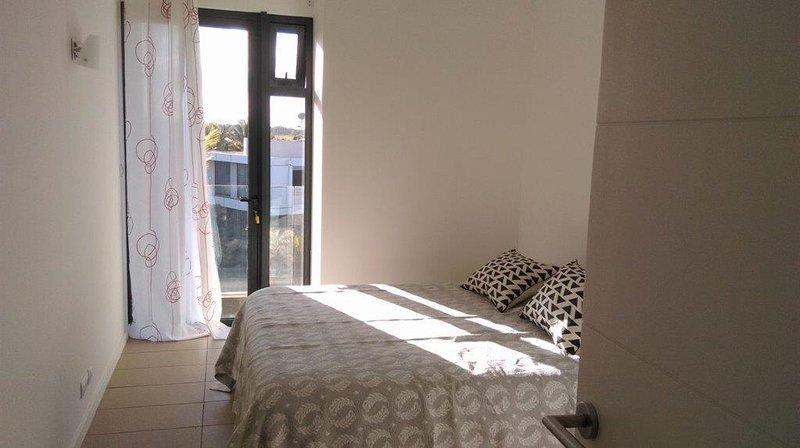 second bedroom with double wardrobes also and opening onto front veranda