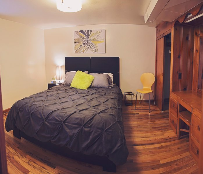 Comfy queen-sized bed with tons of closet and storage space. Quiet and relaxing space.