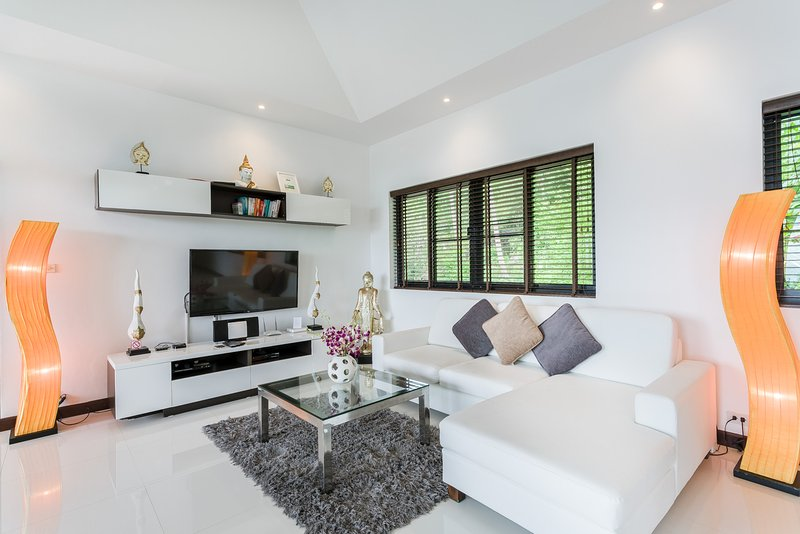 Lounge area with flat screen TV and Apple TV box to stream from your device