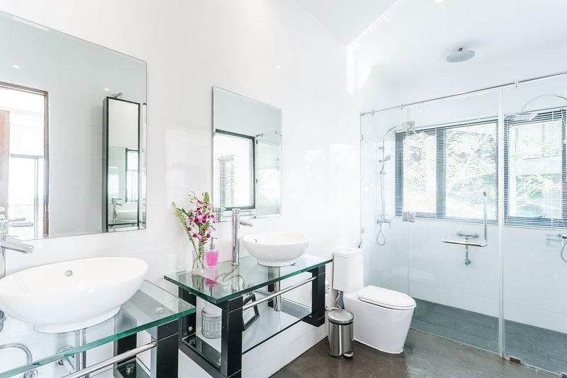En-suite to the master bedroom with triple walk in shower and double sink