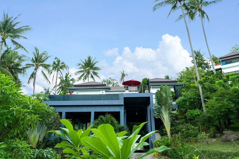 View of the villa from the garden and parking area for serval cars