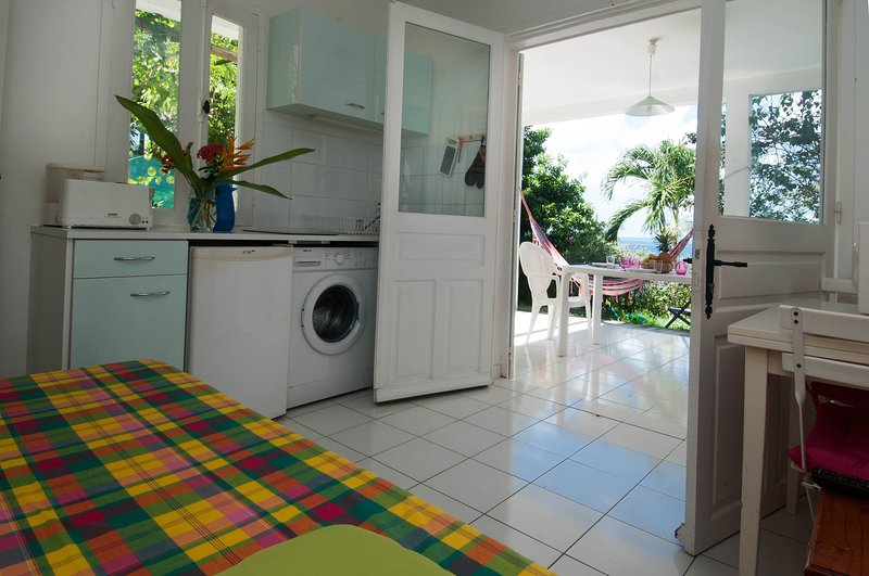 the front room with brand new kitchen, WASHING MACHINE. TV TNT. WIFI everywhere.
