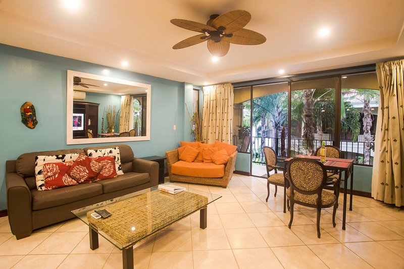 Second floor condo with pool and garden view